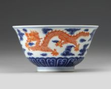 A CHINESE BLUE AND WHITE IRON-RED DECORATED 'DRAGON' BOWL, SIX-CHARACTER JIAQING MARK AND OF THE PER