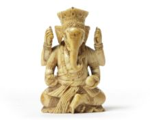 AN INDIAN IVORY SEATED GANESHA,17TH CENTURY