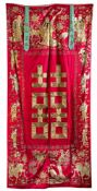 A CHINESE RED-GROUND SILK EMBROIDERY,19TH CENTURY