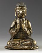 A CHINESE GILT BRONZE FIGURE OF A BUDDHA, LATE MING DYNASTY, 17TH CENTURY