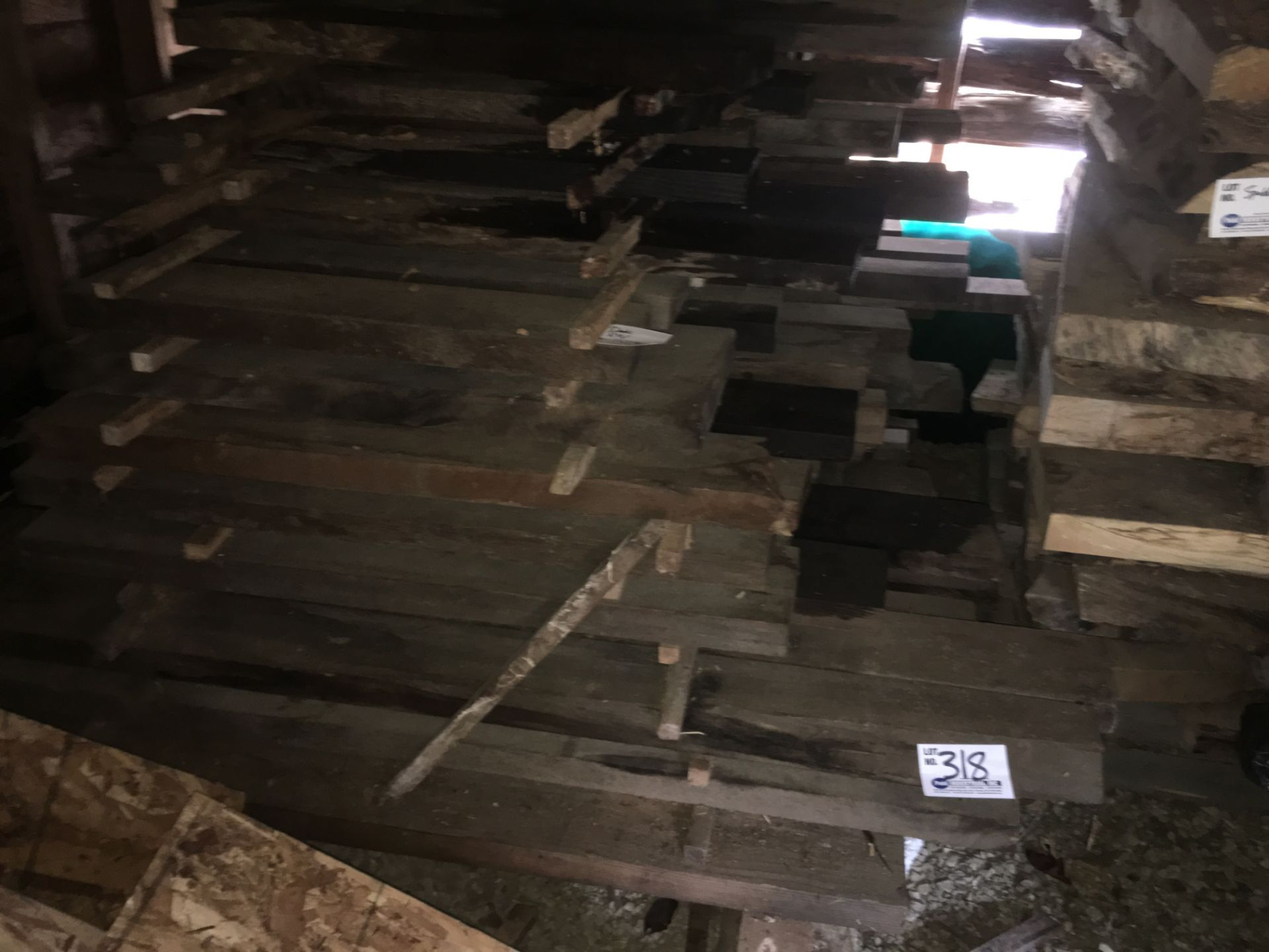 Lot 318 - 2' Thick assorted length Dark Redwood boards in shed