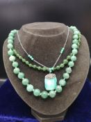Lot of jade necklaces.