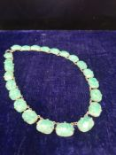 Jade / white metal necklace.