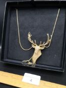 Butler Wilson stag necklace with display box..