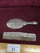 Silver baby's comb and mirror set marked 900..