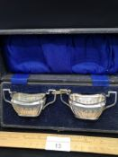 Pair of Antique white metal art deco sugar bowl with double handles in fitted presentation box.