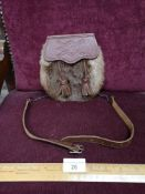 Vintage celtic sporran in brown leather.