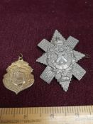 9ct gold plated medal together with large military badge.