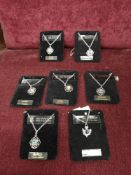 Lot of 7 scottish art pewter chains and pendants.