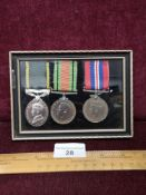 3 World War two medals to include territorial medal to f hinde 2584598. In fitted display.