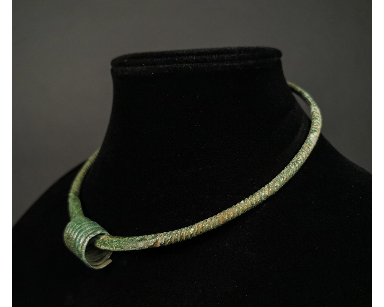 Lot 33 - VIKING BRONZE TORC WITH RING
