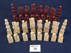 Chinese style resin chess set in two compartment wooden box . (B.P. 21% + VAT)