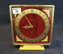 Imhof eight day Swiss mantel clock of square form on a gilt base, having gilt foliate mounts. Height