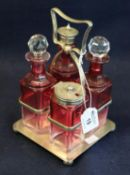 Early 20th Century silver plated and cranberry four piece cruet set on stand. (B.P. 21% + VAT)