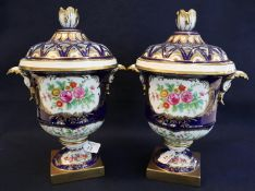 Pair of continental decorative porcelain urn shaped two handled lidded vases with pierced