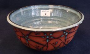 Modern art pottery bowl having blue glaze to the interior and raised splash decoration to the
