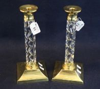 Pair of Waterford lead crystal cut glass and brass candlesticks with facet stems. 28cm high