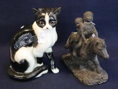 A Goebels German china study of a seated cat, 27cm approx. Together with a bronzed resin Thelwell