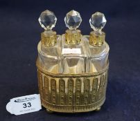 Swiss gilt metal musical box scent bottle holder, having three glass scent bottles with prismatic