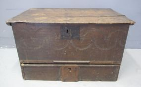 SMALL 17TH CENTURY OAK COFFER with moulded edged hinged top above plain front with chip carved