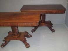 PAIR OF MID VICTORIAN MAHOGANY SIDE TABLES having shaped top above wrythen pedestal and standing