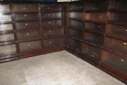 A RUN OF EARLY 20TH CENTURY GLOBE WERNICKE FIVE SECTIONAL GLAZED BOOKCASES with unusual central