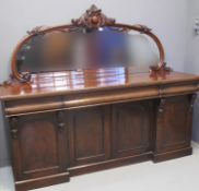 VICTORIAN MIRROR BACK SIDEBOARD having carved and moulded foliate decoration, above a moulded top,