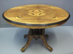 VICTORIAN WALNUT AND MIXED WOODS INLAID TILT TOP CENTRE TABLE of oval form and small proportions,