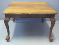 EARLY 20TH CENTURY MAHOGANY EXTENDING DINING TABLE with rope twist edge above carved foliate and
