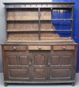 18TH CENTURY CARDIGANSHIRE OAK DRESSER probably altered from a mule chest, having boarded two