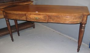 19TH CENTURY MAHOGANY BOWFRONT SIDEBOARD having shaped top above a central single drawer, standing
