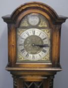 20TH CENTURY STAINED OAK LONGCASE CLOCK having arched hood above brass face with silvered Roman