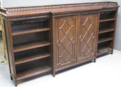 LATE VICTORIAN MAHOGANY BREAK FRONT BOOKCASE by C. Hindley, Oxford St, London, having pierced