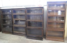 THREE EARLY 20TH CENTURY OAK GLOBE WERNICKE FOUR SECTIONAL BOOKCASES with copper banding and Globe