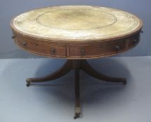 EARLY 20TH CENTURY MAHOGANY REVOLVING DRUM OR CENTRE TABLE of circular form with leather inset top