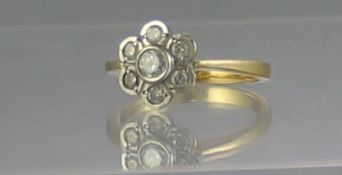 18CT GOLD DIAMOND SEVEN STONE DAISY CLUSTER RING. Ring Size O. Weight 4.1g approx. (B.P. 21% +