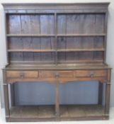 18TH CENTURY OAK TWO STAGE RACK BACK POT BOARD DRESSER having moulded cornice above 'missing' shaped
