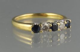18CT GOLD SAPPHIRE AND DIAMOND HALF ETERNITY RING of two brilliant cut diamonds and three sapphires.