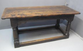17TH CENTURY STYLE OAK REFECTORY TABLE having three plank cleated top above arcade frieze