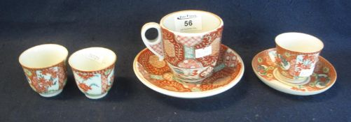 Japanese Arita porcelain large cup and saucer, overall decorated in stylised geometric and foliate