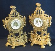 Pair of French design flat backed gilt metal figure mounted cartel type clocks with back winding