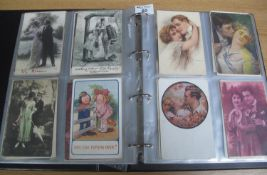 Postcards collection in black album featuring romantic couples from the early 1900's. 200 +