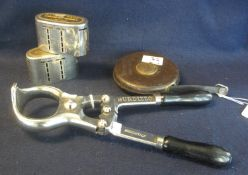 Two similar Lloyds bank oval section plated metal money boxes. Together with a Chesterman leather