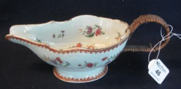 18th Century Chinese porcelain Qianlong period gravy boat, having overall foliate spray decoration