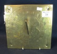 A brass engraved square sun dial with Roman numerals, Royal coat of arms and date 1710 over 'Docet