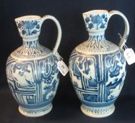 Two similar Japanese Arita porcelain baluster shaped wine jugs with loop handles, overall