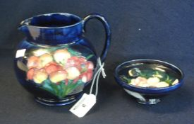 Mid Century Moorcroft art pottery tube lined single handled jug of baluster form on a blue ground