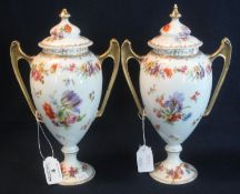 Pair of German porcelain floral transfer printed two handled urn shaped vases and covers, crowned