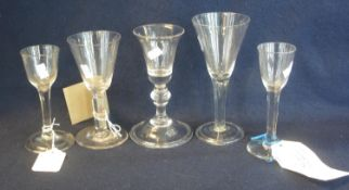 A group of assorted Georgian style wine glasses to include; bell shaped glass with knop stem and