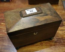 19th Century sarcophagus shaped rosewood tea caddy with two compartments on ball feet. 21cm wide